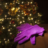 Pink gloves at Christmas Royalty Free Stock Photography