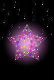 Pink glowing Christmas star hanging with snow Stock Images