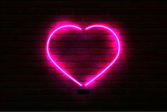 Pink glowing neon heart on brick wall background royalty free illustration