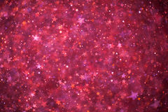Pink glowing stars background Stock Photography