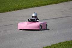 Pink Go Kart. Young Girl racing a Pink Go Kart at a track Royalty Free Stock Photos