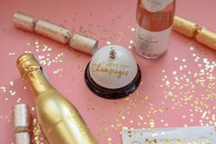 Pink and gold champagne background for fun girls night out. Pink and gold champagne background with bell that says Press for Champagne - girls night out concept stock photo