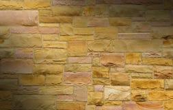 Pink and gold masonry dramatically lit Royalty Free Stock Image