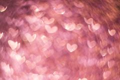 Pink gold, pink rose bokeh,heart abstract light background,Valentines day,women day,event lights romantic backdrop. Blurred abstract holiday background stock images