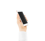 Pink gold smart phone blank screen mock up holding in hand. Royalty Free Stock Photography