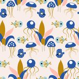 Pink and golde jellyfish, with colotful fishes in a seamless pattern design