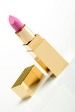Pink golden lipstick. On white background Royalty Free Stock Images
