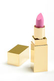 Pink golden lipstick. On white background Stock Photo