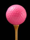 Pink golf ball. On tee Royalty Free Stock Photos
