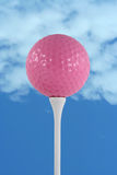 Pink golf ball against blue sky Royalty Free Stock Image