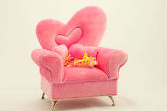 Pink Golf Ball On a Pink Arm Chair Stock Photo