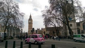 Pink is good. Pink taxi in London, view of the big Ben Stock Image
