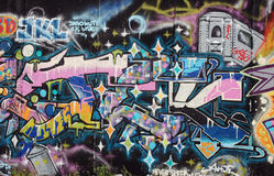 Pink graffiti on the Berlin Wall with train Royalty Free Stock Photo