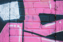 Pink Graffiti Covers Brick Wall Royalty Free Stock Photography