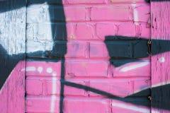 Pink Graffiti Covers Brick Wall Royalty Free Stock Photography