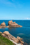 Pink granite cliffs in Saint-Guirec (France) Royalty Free Stock Images