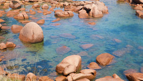 Pink granite coast Stock Photos