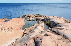 Pink granite coast at the Baltic sea. Pink granite coast of the Baltic sea near Oskarshamn, Sweden Stock Photo