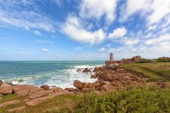 Brittany coast at Ploumanach with its famous lighthouse. The Pink Granite Coast in Brittany, France, and the famous lighthouse of Ploumanach Stock Photo