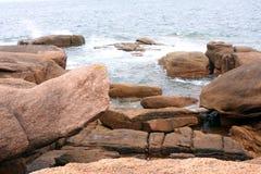 Pink granite coast Stock Photos