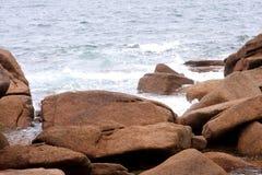 Pink granite coast Stock Images