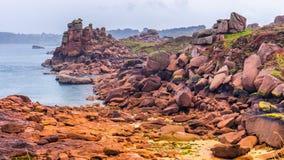 The pink granite coast view, granit rocks in Tregastel (Perros-Guirec), Brittany (Bretagne), France royalty free stock photo