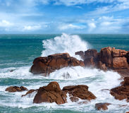 The Pink Granite Coast wave Brittany, France. Ocean coast spring wave view between Perros-Guirec and Pleumeur-Bodou, Brittany, France. The Pink Granite Coast Stock Photos