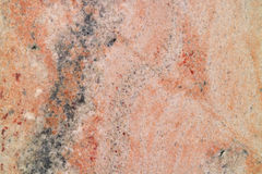 Pink granite with a fine texture. Rare pink granite with a fine texture, natural background stock photo