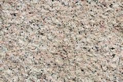 Pink granite magmatic rock. Pink granite rock close up stock photos