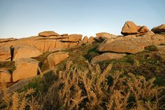 Pink Granite rock coast at Perros Guirec in Brittany. Côte de Granit Rose is one of the most beautiful stretches of Brittany's coastline. The unusual royalty free stock photo