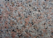 Pink granite. Rock from a decorative stone Stock Photo