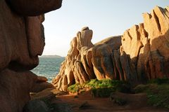 Pink Granite rock formations near Perros Guirec in Brittany. Côte de Granit Rose is one of the most beautiful stretches of Brittany's coastline. The royalty free stock photos