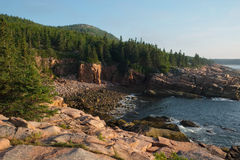 Pink Granite slabs and boulders on a secluded area of beach in M Royalty Free Stock Images