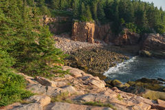 Pink Granite slabs and boulders on a secluded area of beach in M Stock Photos