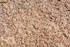 Pink granite textured surface Stock Images