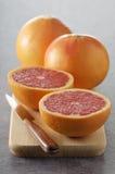 Pink grapefruit cut in half Royalty Free Stock Photo