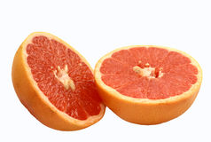 Pink Grapefruit Halves. Isolated pink grapefruit halves on white background Royalty Free Stock Image