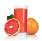 Pink grapefruit juice. Glass of pink grapefruit juice  on white Royalty Free Stock Photography