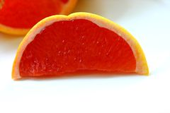 Pink Grapefruit slice Royalty Free Stock Photography
