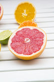 Pink grapefruit and tangerines on white wood Stock Photo