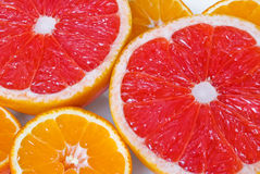 Pink grapefruits and mandarines Stock Photo