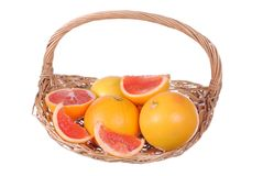 Pink grapefruits in a straw basket Stock Photo