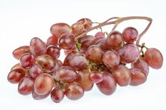 Pink grapes isolated on white background. Bunch of pink grapes on a white background royalty free stock photo