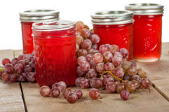 Pink grapes with jars of grape jelly Stock Photo
