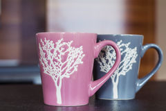 Pink and gray cups Stock Photos