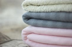 Pink and gray plaid with folded towel close-up stock photo