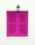Pink Greek Style windows and lamp Royalty Free Stock Photography