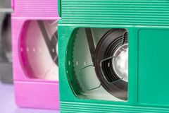 Pink, green and black VHS cassettes stock photo