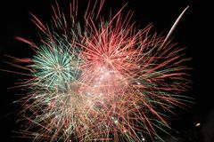 Pink and Green Fireworks Display during Nighttime stock image