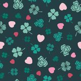 Pink and green Irish symbols design with hand drawn shamrocks and hearts. Ideal for St Patricks day, paper, scrap booking and as. Pink and green Irish symbols vector illustration